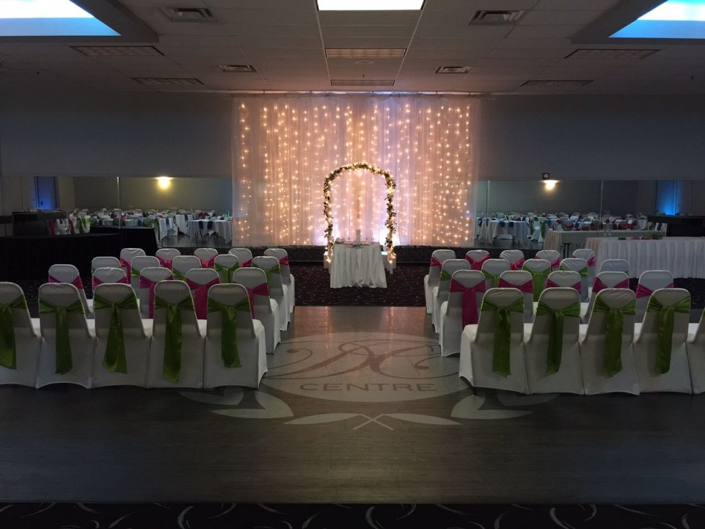 A beautiful indoor ceremony at Omaha wedding venue DC Centre.
